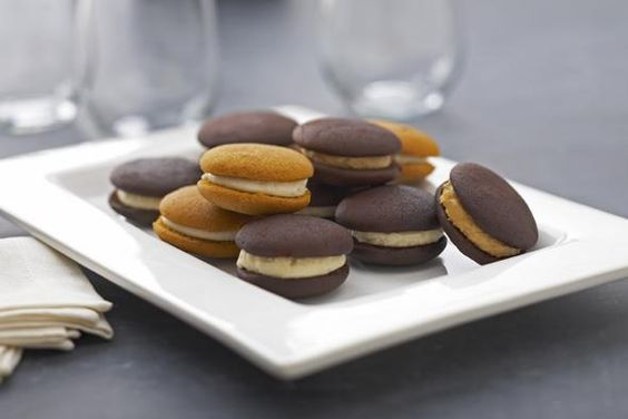 Pumpkin Whoopie Pies, Chococoa Baking Company & Cafe: To make these, a spoonful of ginger cream cheese is sandwiched between two pumpkin spice cakes.