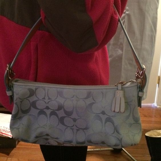 "Light Blue Coach Purse 5.5"" h X 11"" w.  With 8"" height strap for arm.  In  good condition with outside corners on bottom slightly showing darkening from light use. Coach Bags"