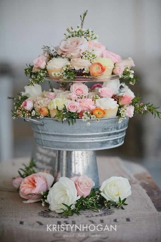 I love this for centerpieces! use a tin can base, glue on a pretty pie plate, glue in a small cake stand (or a candle holder and a tea cup saucer) and then fill in with cupcakes and flowers! beautiful centerpieces and dessert at every table!!!!: