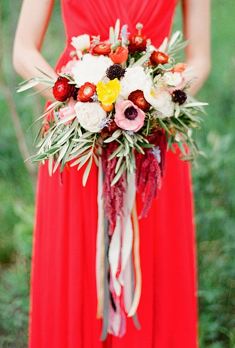 A Colorful Mixed Bouquet with White, Pink, and Red Peonies, Anemonies, and Greenery Fall Wedding Bouquet