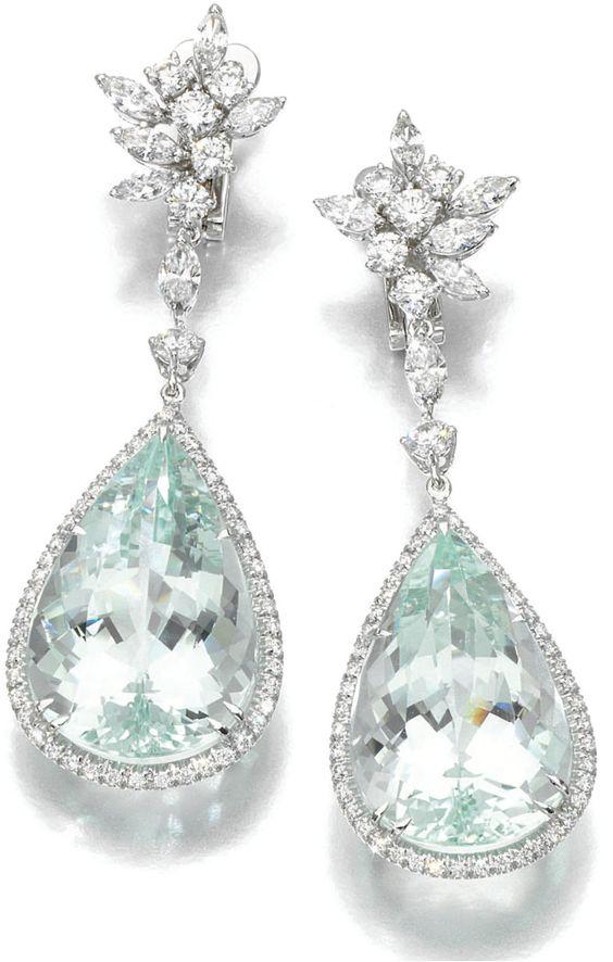 Aquamarine and diamond earrings by Margherita Burgener. Each foliate diamond surmount on suspends a pear-shaped aquamarine within a border of brilliant-cut diamonds.  Via Diamonds in the Library.