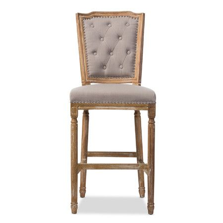 Rustic country charm is captured in the Julie French Vintage Cottage Weathered Oak Beige Linen Upholstered Barstool. A subtle weathered oak effect finish ...