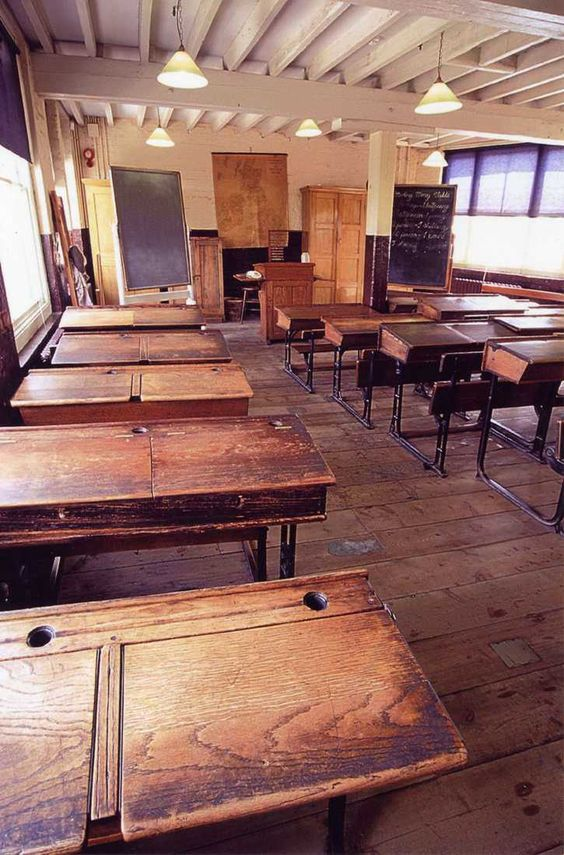 this was what my school desk looked like, but the classroom was more old fashioned than this one - these desks seated two kids - there were 40 girls in my class so there were four rows of five desks - date 1953 to 1957