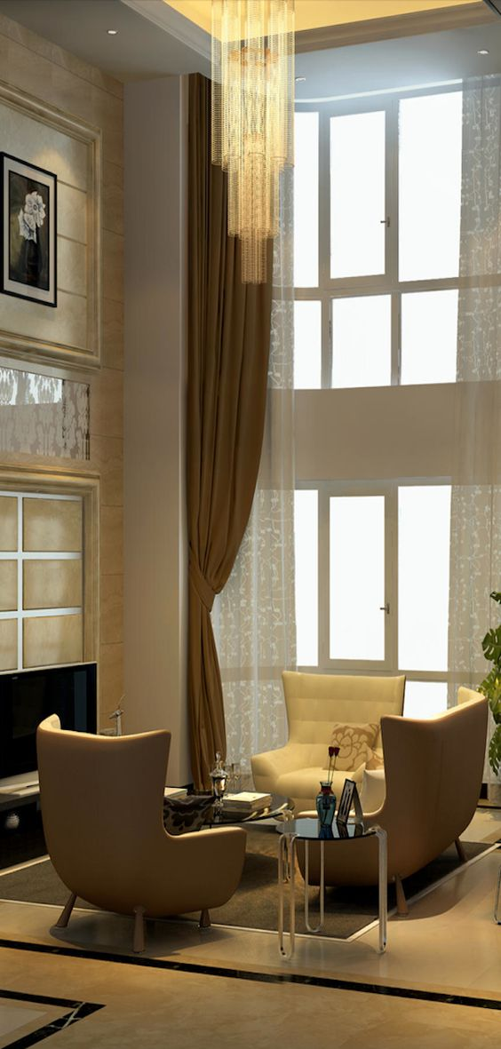 Fireplace and artwork hung high complements windows cool High ceiling window treatments