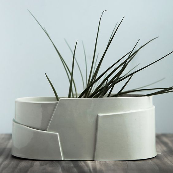 Loosely based on the shape of a spiral, this vessel was hand built with carefully cut fragments of porcelain slabs to create a structured, tiered