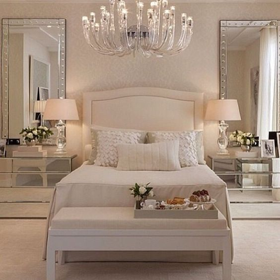 the matching mirrored night stands and mirrors above are an