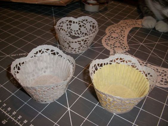 Making cupcake wrappers from dollar store doilies - thinking that the gold doilies would be perfect for my parents' 50th wedding anniversary - and they look a whole lot easier to work with than my cricut cartridge!