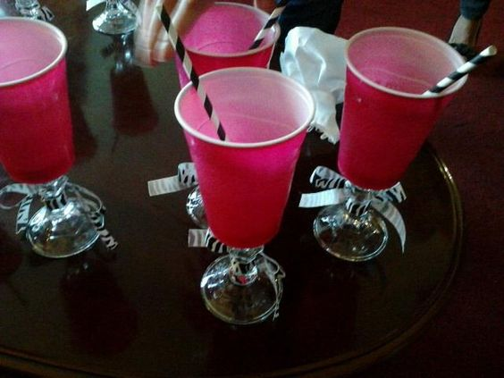 Our drinking cups at Katie D.'s bachelorette party last night! Pink solo cup on top of glass candle stick. Too cute.