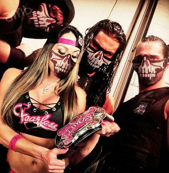 Nikki Bella w/ Roman Reigns Dean Ambrose & Seth Rollins