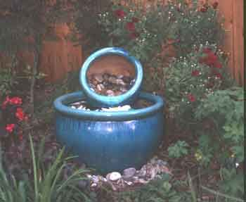 Two glazed clay pots form a simple recirculating water for Pot water feature ideas