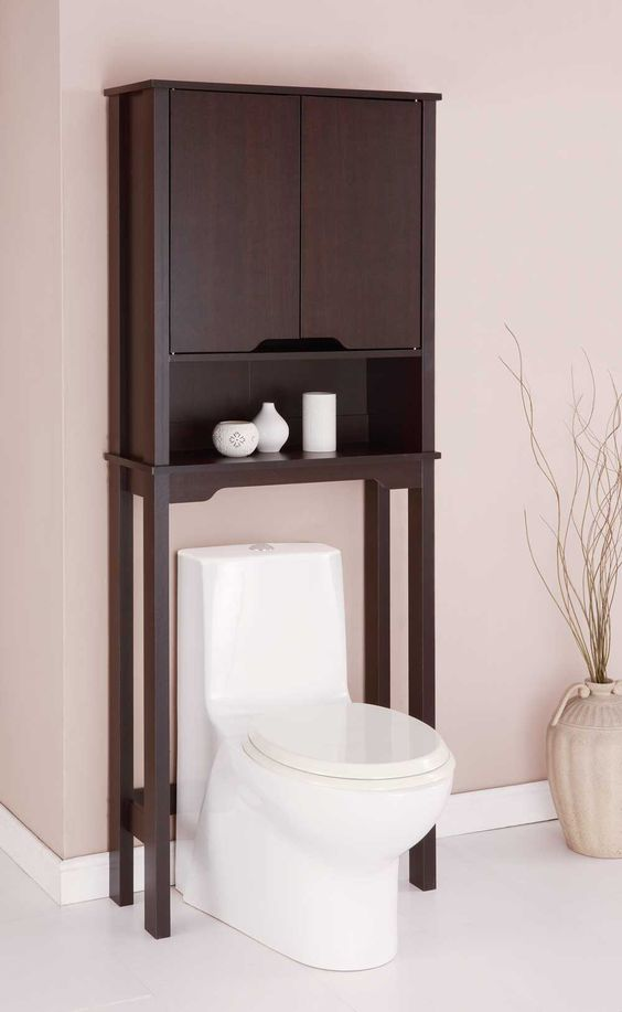 over toilet cabinet space saver is a wood veneer cabinet that fits over