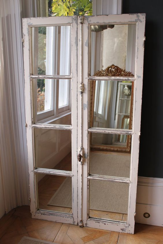 Lovely set of antique French windows finished with mirrored panels.  Chippy paint in chalky white with original blue paint coming through  174cm