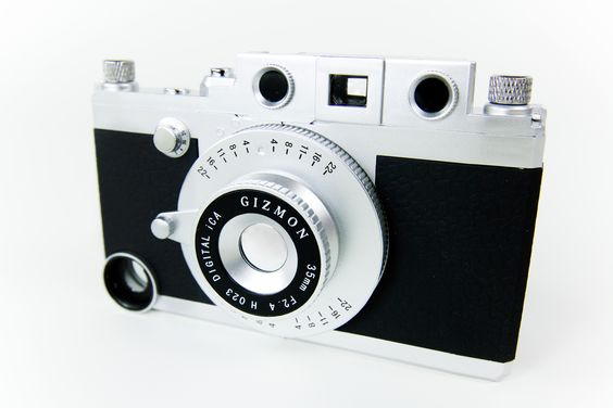 The iPhone Rangefinder - A shutter button, tripod mount, viewfinder, and magnetic lenses for a complete phoneography system. ($65.00, http://photojojo.com/store)