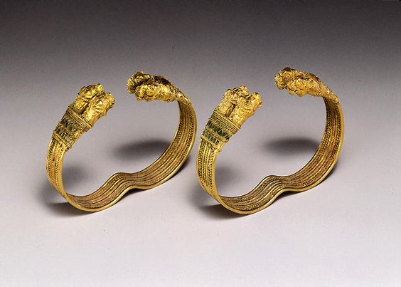 Pair of Bracelets with Double Lion's-head Terminals ProvenanceIran PeriodPersia, Achaemenid period Yearpossibly 4th century B.C. MaterialsGold with cloisonne inlay and vitreous paste DimensionsH-4.5 W-6.2