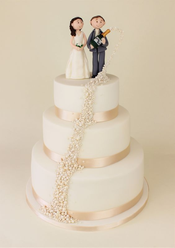 Wedding cake with champagne bubbles flowing
