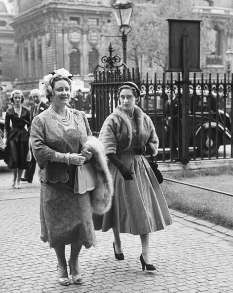 The Queen Mother and her daughter Princess Margaret arriving for the society wedding of John Spencer, Viscount Althorp, to Frances Roche at Westminster Abbey, London, 1954. They were the parents of Diana, Princess of Wales. || Carl Mydans