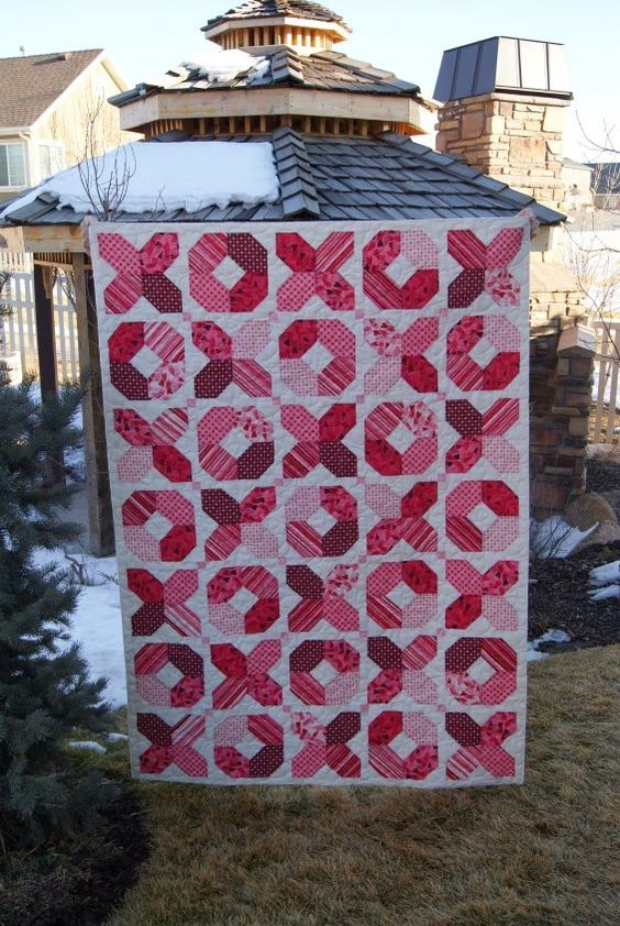 Chocolate Dipped Quilts: XOXO Valentine Quilt - my girl would like a purple background with bright red x & O's!: