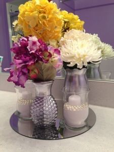 Vases spray painted chrome with glass jars filled with sand, pearls, and a candle all on a circular mirror.    http://kristinadefined.wordpress.com/