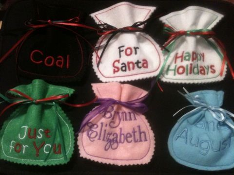 Great little felt treat bags! These bags will hold 4 mini candy bars or small trinkets. They make great stocking stuffers, you can fill with candy, gift cards, money or other small gifts. These bags will also make great party favors! These favors can be personalized  and used for shower treat bags and weddings!
