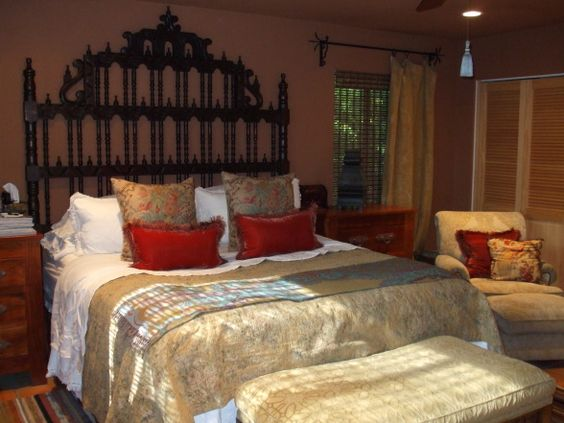 I love the warmth of this spanish colonial inspired bedroom.