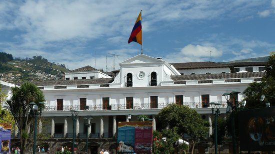 Ecuador Government's palace, white building with an Ecuadorian flag on top