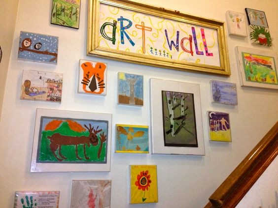 Kids art wall using cheap plastic frames that we used to - Fun painting ideas for walls ...