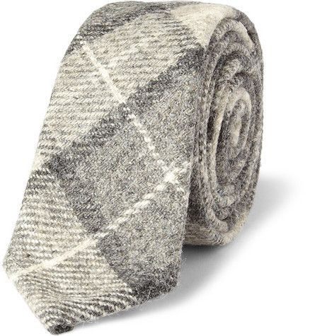 Thom Browne. Plaid Wool Tie. American label Thom Browne often uses variants of the same colour in one look, placing emphasis on fabrics and patterns. Wear this plaid wool tie with a grey suit and white shirt to highlight its dashing design.