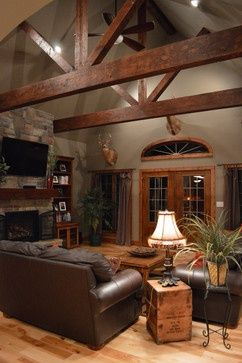 Rustic wood moulding looks beautiful against the gray for Western living room designs
