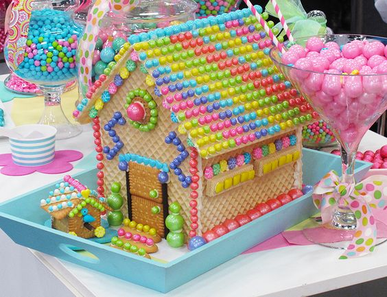 Whimsical and bright vivid colors on a Gingerbread house made with wafter cookies