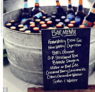 big beer ice buckets to spread around...Love the chalkboard idea for listing bar menu!!