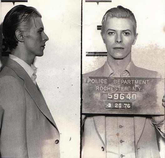 Bowie mugshot, 1976.  David Bowie,  snapped in Rochester, New York following the singer's March 1976 arrest on a felony pot possession charge. Bowie, 29 at the time, was nabbed along with Iggy Pop and two other codefendants at a Rochester hotel following a Saturday concert.