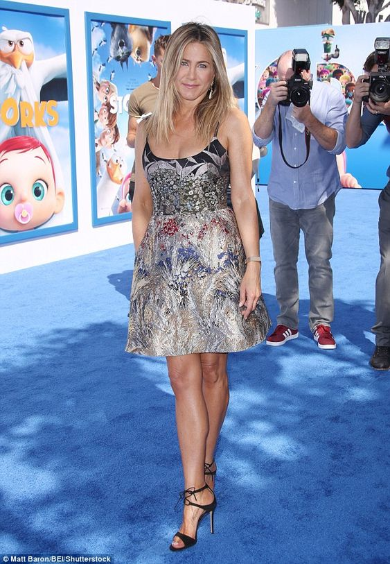 Feather in her cap: Jennifer Aniston showed off her impeccable style at the Los Angeles pr...