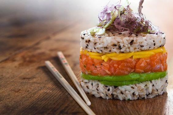 Sushi Burger! Layers of black-sesame-flecked sushi rice, salmon tartare, mango, avocado.: