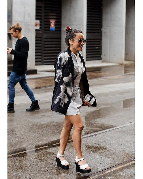 Street style at fashion week. - over the shoulder jacket