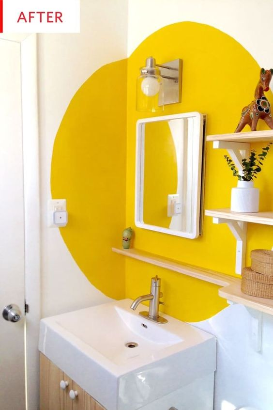 This bathroom makeover only cost $130. We love the new shelving, mirror and especially the unique paint color and design. This is proof that you can transform your bathroom on a budget.