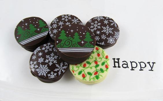 Fun Winter Holiday Designs - Chocolate Covered Sandwich Cookies - http://americanchocolatedesigns.com/transfer_sheets.php#cookies
