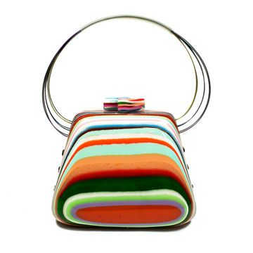 (1 left)**Pop Art Purse Carmen**  by Sobral**This petite clamshell purse is perfect for a night on the town. Especially if it's a hot one! Each slightly tapered, colorful purse is made by hand. First, layers of multicolored resin and a touch of glitter are poured into a mold. Then each piece is hand polished to a beautiful luster. Slim wire handles finish off this essential night-out accessory. You'll want to sit at the bar where your handbag can have the spotlight
