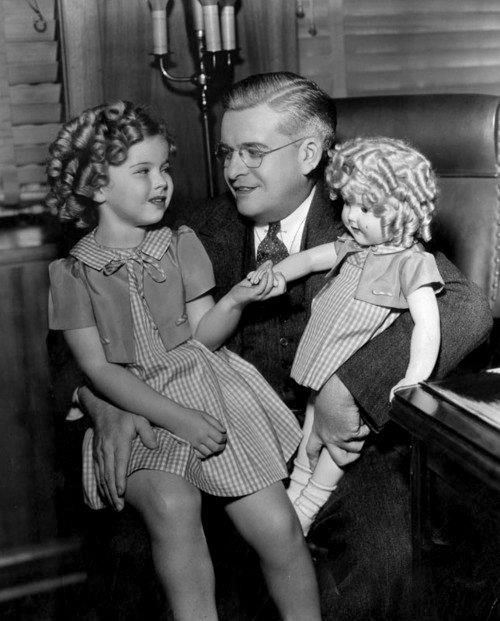 I don't think little Shirley is very sure about the man she is sitting on. I feel bad for her. It is obvious by her expression, they made her sit on his lap for the publicity photo.