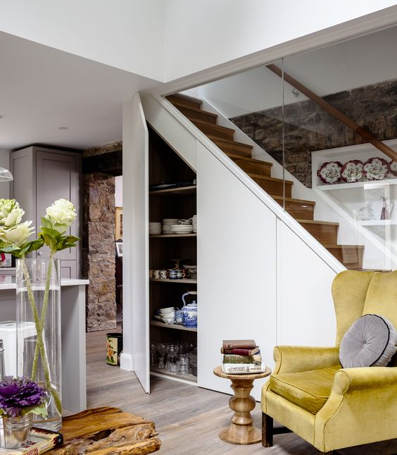 bespoke stairs design with understair storage glass balustrade with exposed stone wall interior architecture bespoke wall storage