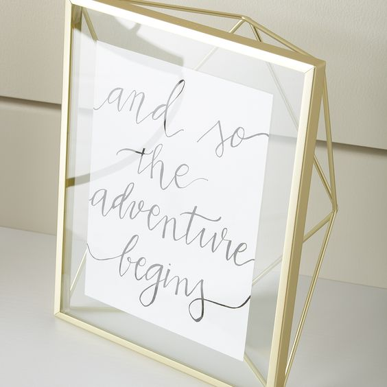Instantly add touches of your home and style to your dorm room! Use it for photos of home or for cute quotes about your new adventure at school this fall. Add depth and dimension to your photo displays with our Prisma Photo Frames by Umbra. These prismatic, brass wire frames allow your photos to float between two panes of glass for a beautiful presentation whether sitting on the desk or hung on the wall.