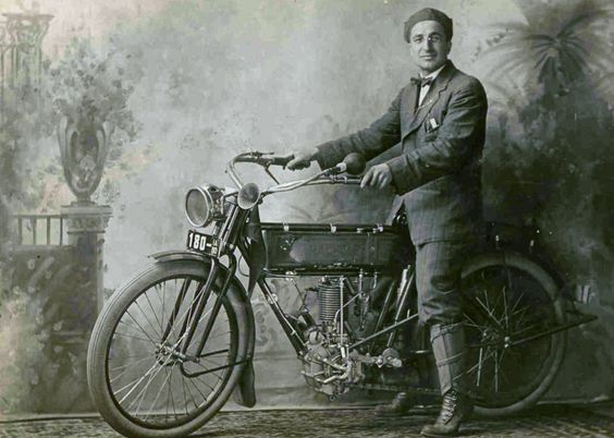 1913 when riding a motorbike wearing a suit and a bowtie for What is considered antique