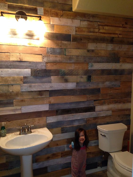 Pallet wood slats accent wall in our bathroom i did and for Bathroom ideas made from pallets