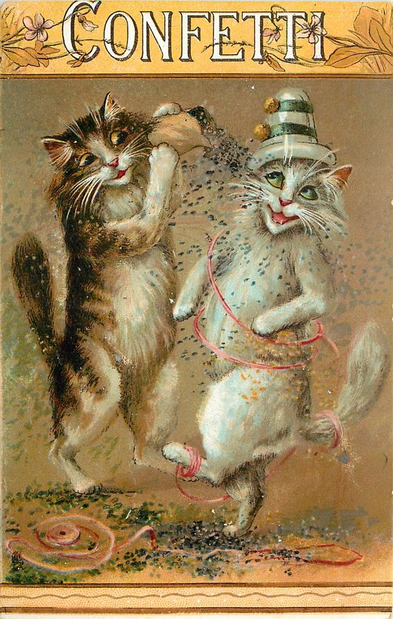 CONFETTI two cats on hind legs, one throws confetti on the other: