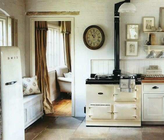 Country Kitchen Fridge: AGA Stove, SMEG Fridge, Soothing Cream-colored Kitchen