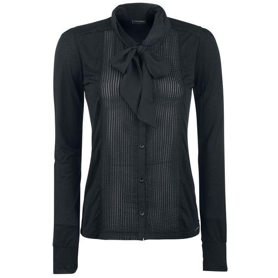 Das Schick nicht unbedingt langweilig sein muss, beweist Vive Maria mit der Bluse 'Black Betty'. Das schwarze Oberhemd wird von einer großen Schluppe verziert und hat leichte Raffungen an den Schultern. Durch den transparenten Stoff lässt du außerdem tief blicken.