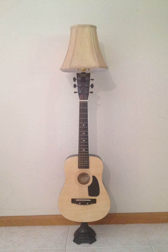 Re purposed and recycled guitar with salvaged lamp parts would make a