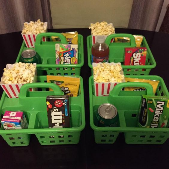Great and inexpensive idea for a movie night party. You can find the totes at any dollar store, and the popcorn tubs, too!