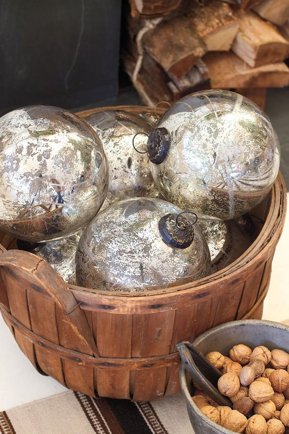 Mercury Glass Ornaments - Get The Look: Rustic-Casual Christmas - Southernliving. Add a bit of subtle shimmer to the neutral tree with silvery-gray mercury glass ornaments in various sizes. Antique mercury glass can be pricey, but this set is available for a song.  Get the Look: Etched Mercury Glass Ball Ornaments, $18 (set of 6)