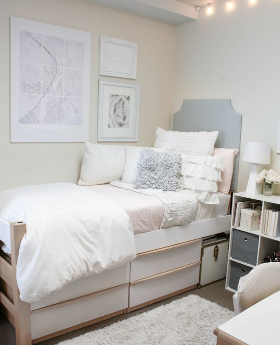 Pretty bedding with great pillows, simple headboard, art instead of posters on the wall. Cal Poly Gypsum Hall