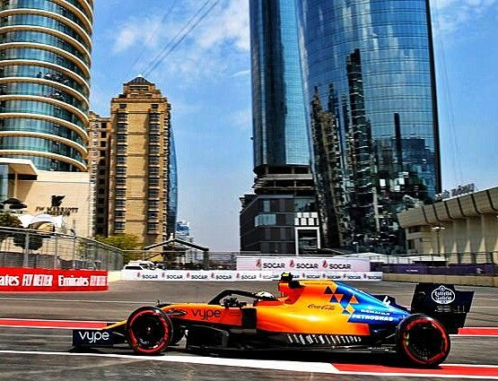 Mclaren Driver Lando Norris Powering Past Baku Skyscrapers At Practice For The Race F1 Formula1 Azerbaijangp Baku Bakuci Baku City Formula Racing Car 15